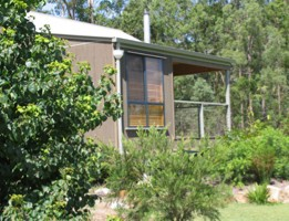 Tuckeroo Cottages and Gardens Logo and Images