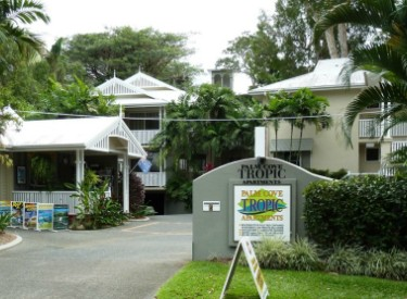 Palm Cove Tropic Apartments Logo and Images