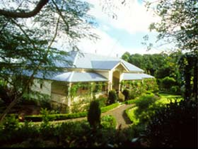 The Falls Rainforest Cottages Logo and Images