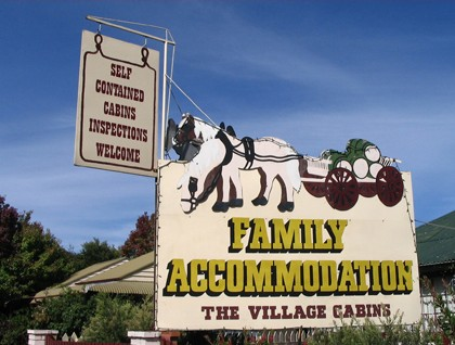 The Village Cabins Logo and Images