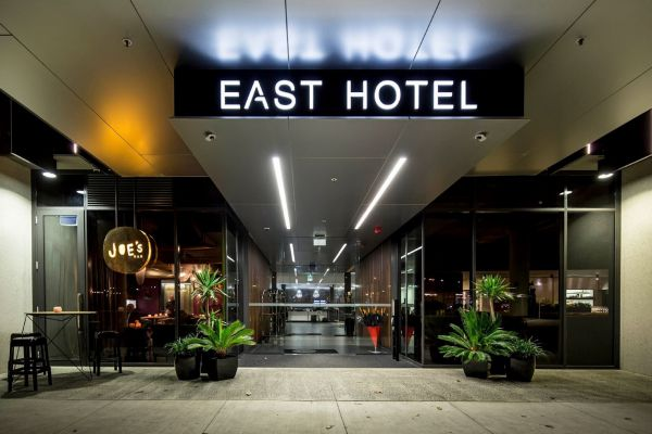 East Hotel + Apartments Logo and Images