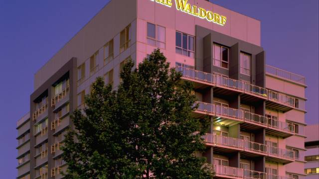 Waldorf Canberra Apartment Hotel Logo and Images