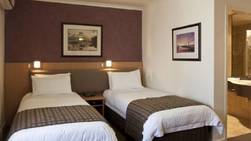 BEST WESTERN PLUS Travel Inn Hotel Logo and Images