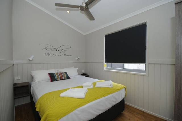 Nobby Beach Holiday Village Logo and Images