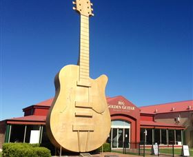 Big Golden Guitar Tourist Centre Logo and Images