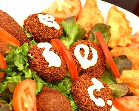 Al-Madina Lebanese Cuisine Logo and Images