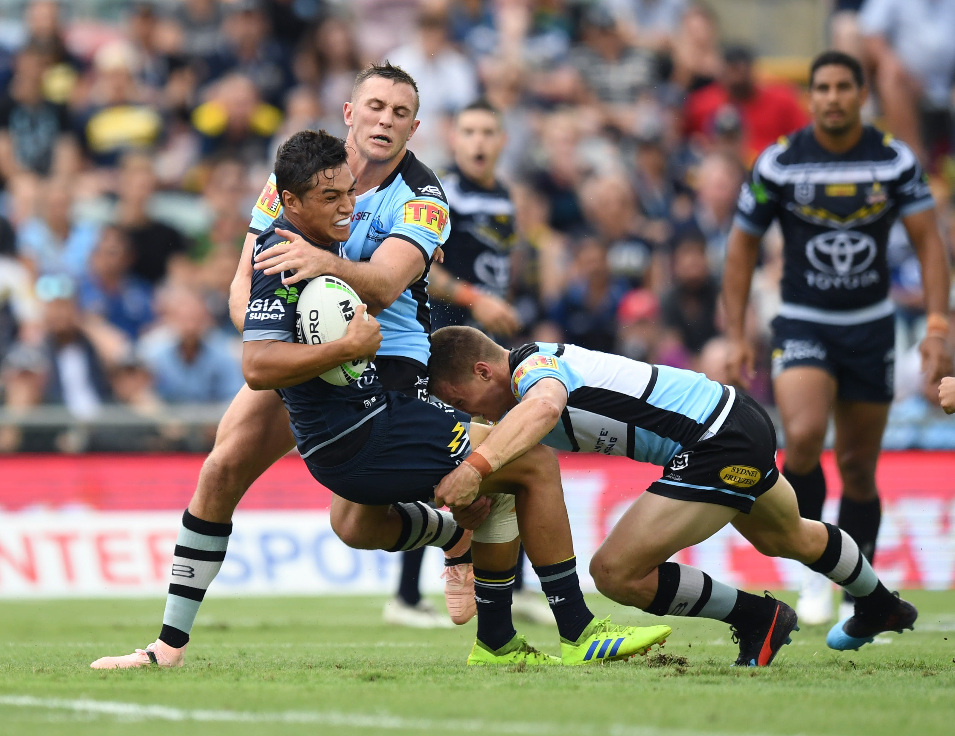 North Queensland Toyota Cowboys versus Cronulla Sharks Logo and Images
