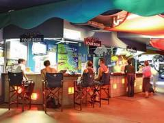 Nomads Cairns Backpackers Resort & Serpent Bar & Bistro Logo and Images