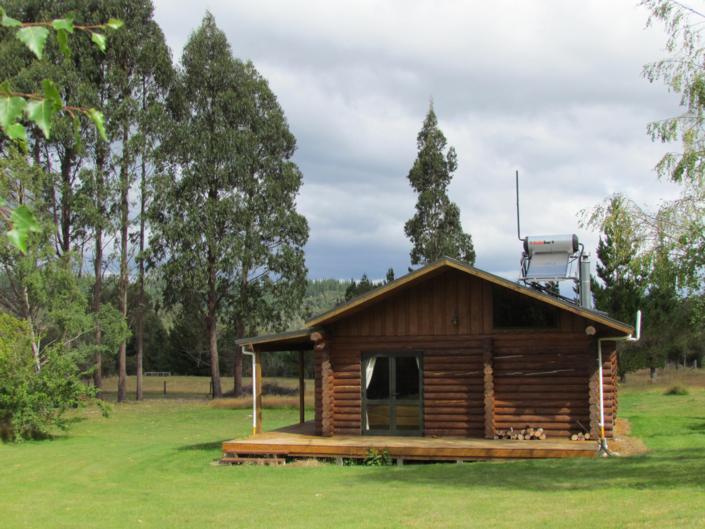 Triple Tui Log Cabin