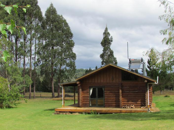 Triple Tui Log Cabin