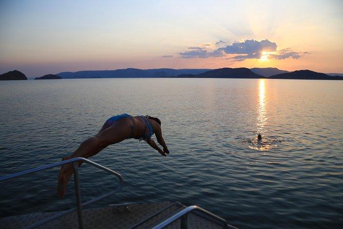 Lake Argyle Sunset Magic Cruise Departing Lake Argyle Logo and Images