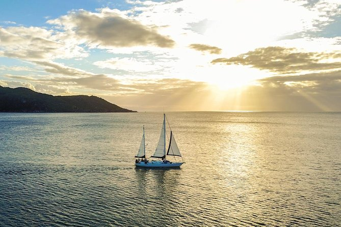 Magnetic Island Sunset Sail Logo and Images