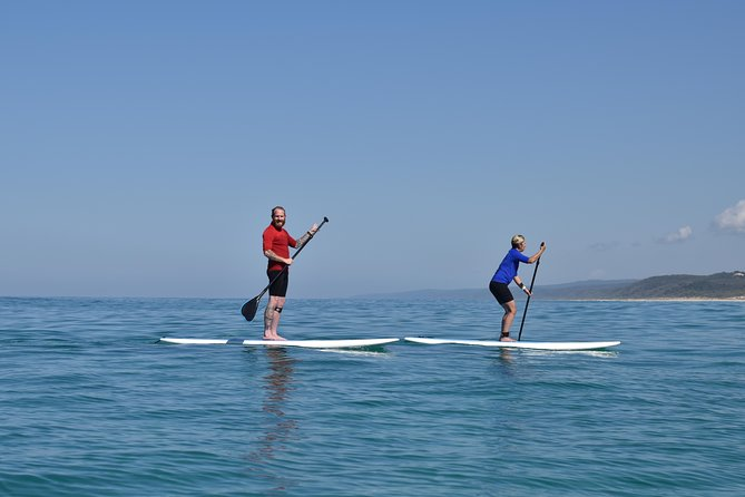 Stand Up Paddle Double Island Lesson Logo and Images