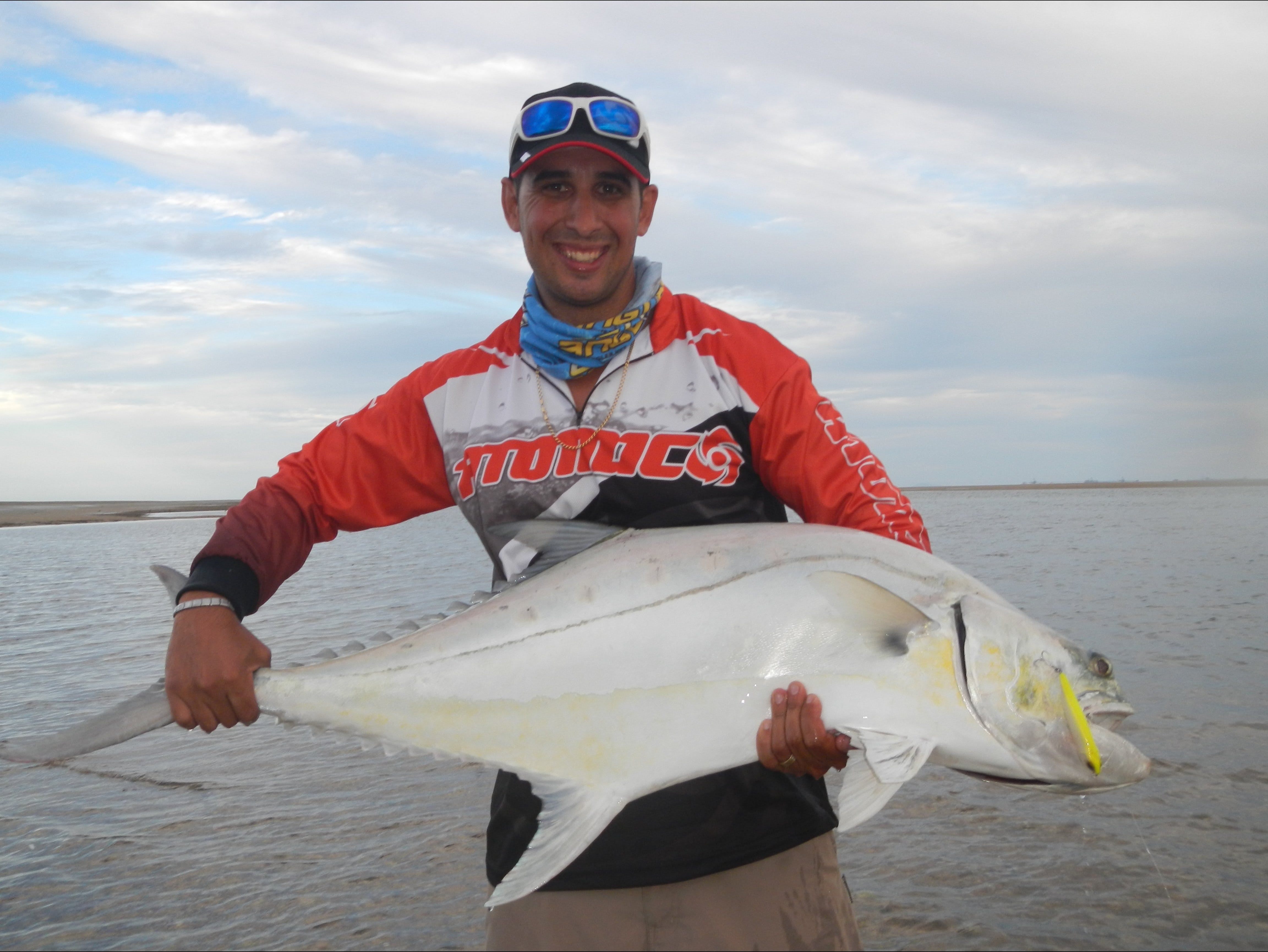 Reel in a Trophy - Fishing Adventure in Tropical Queensland! Logo and Images