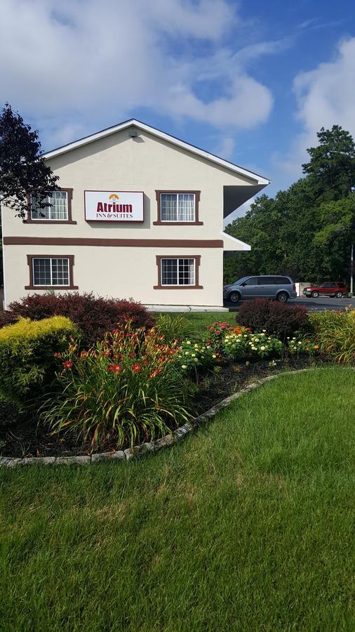 Atrium Inn  Suites