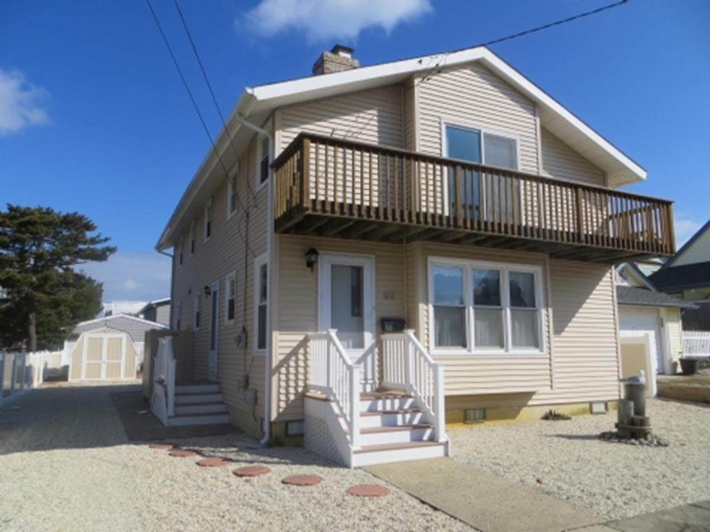 Brant Beach Oceanside home with a short walk to the beach. Get a peek of the Ocean/Bay views fro the Master bedroom deck. Large